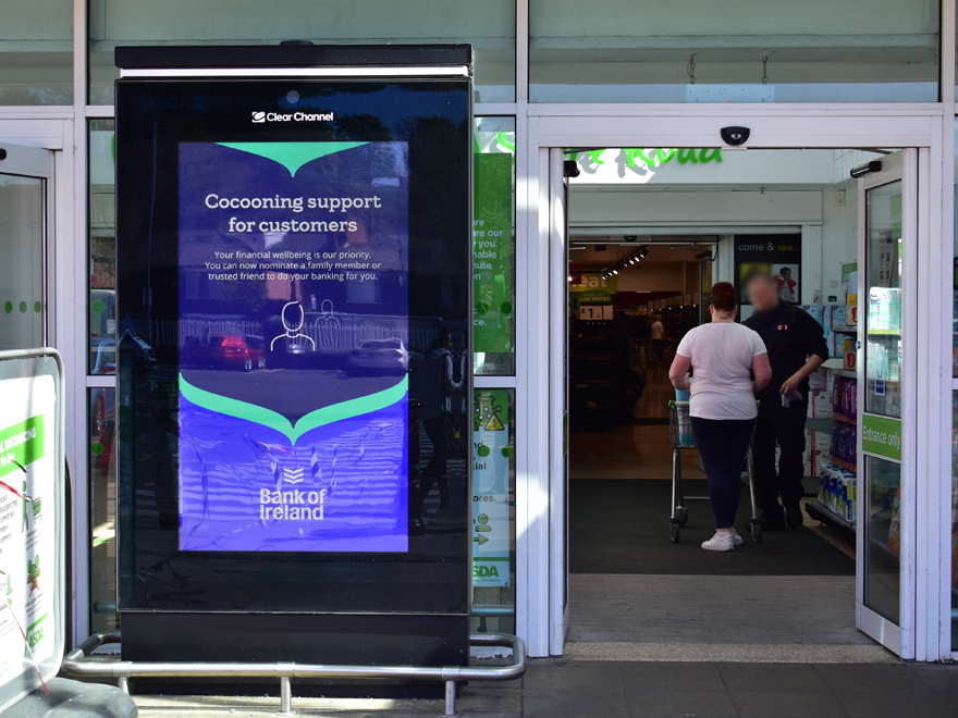 Digital screen at Asda store with Bank of Ireland cocooning campaign message